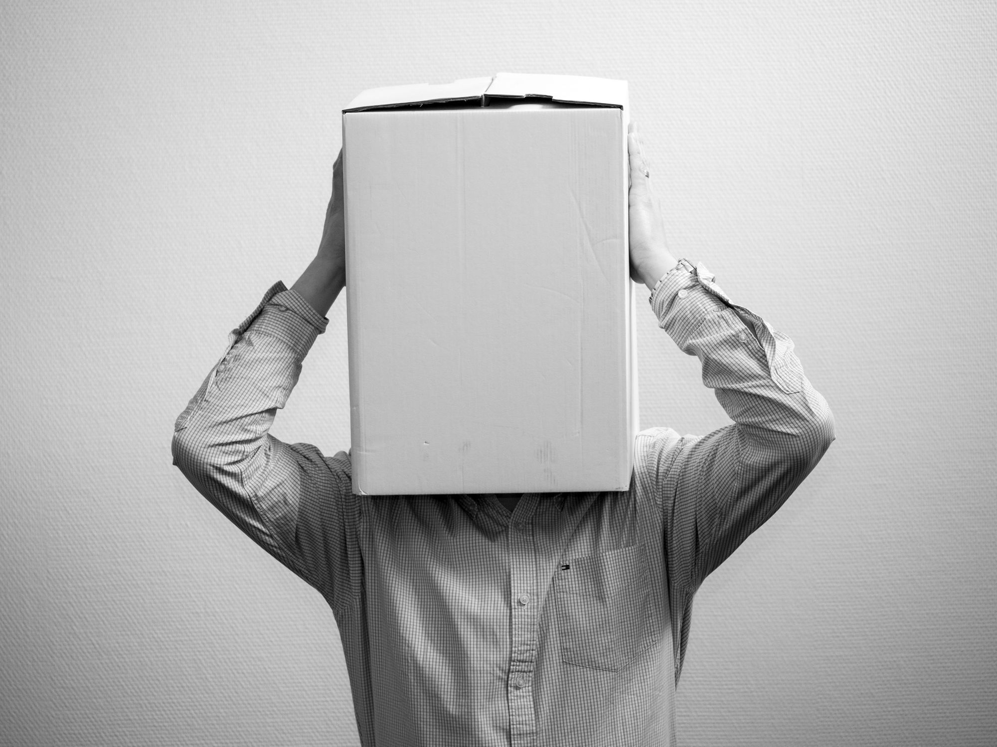 man with a box in the head