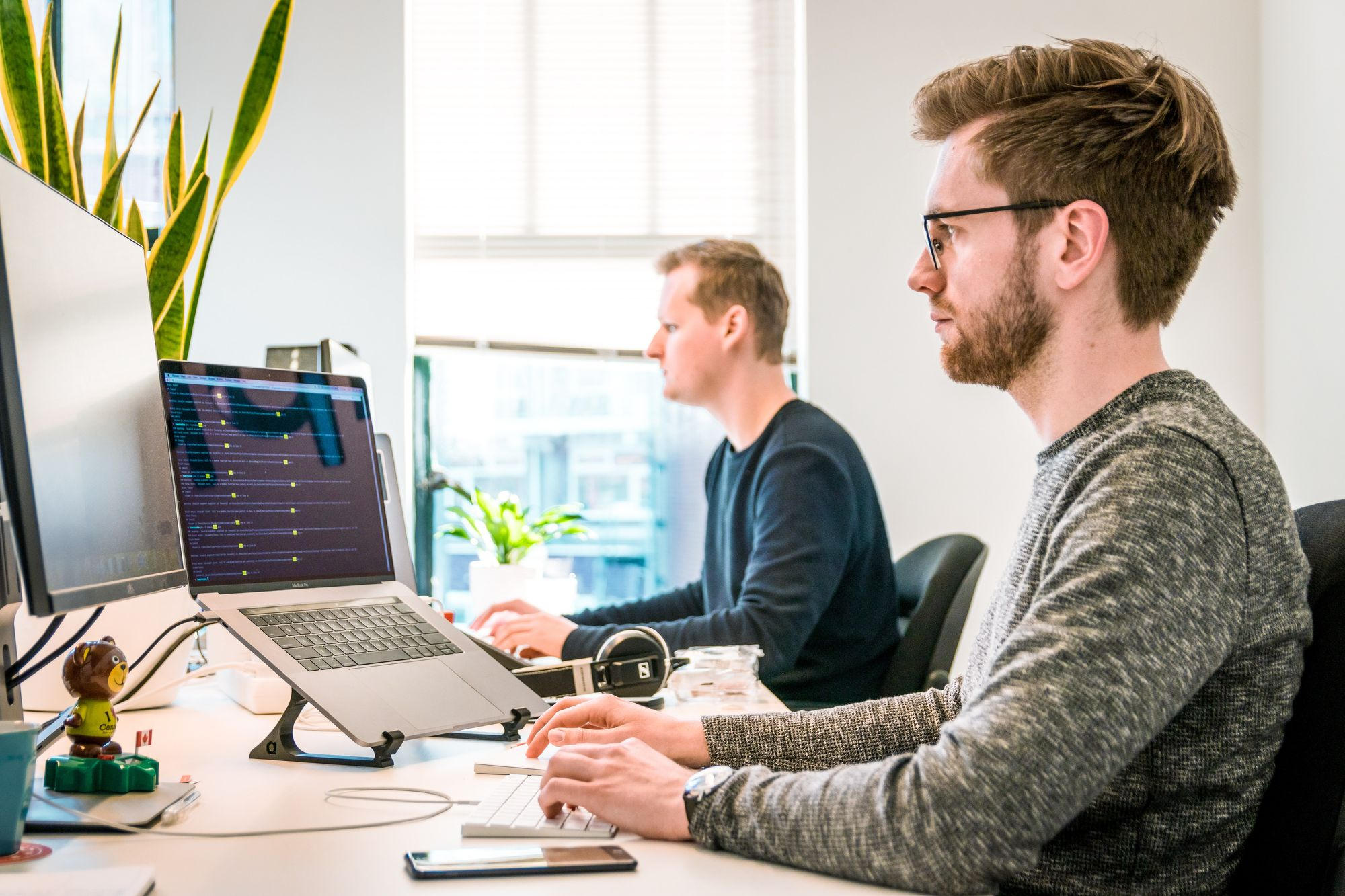 two software developers working during thee day