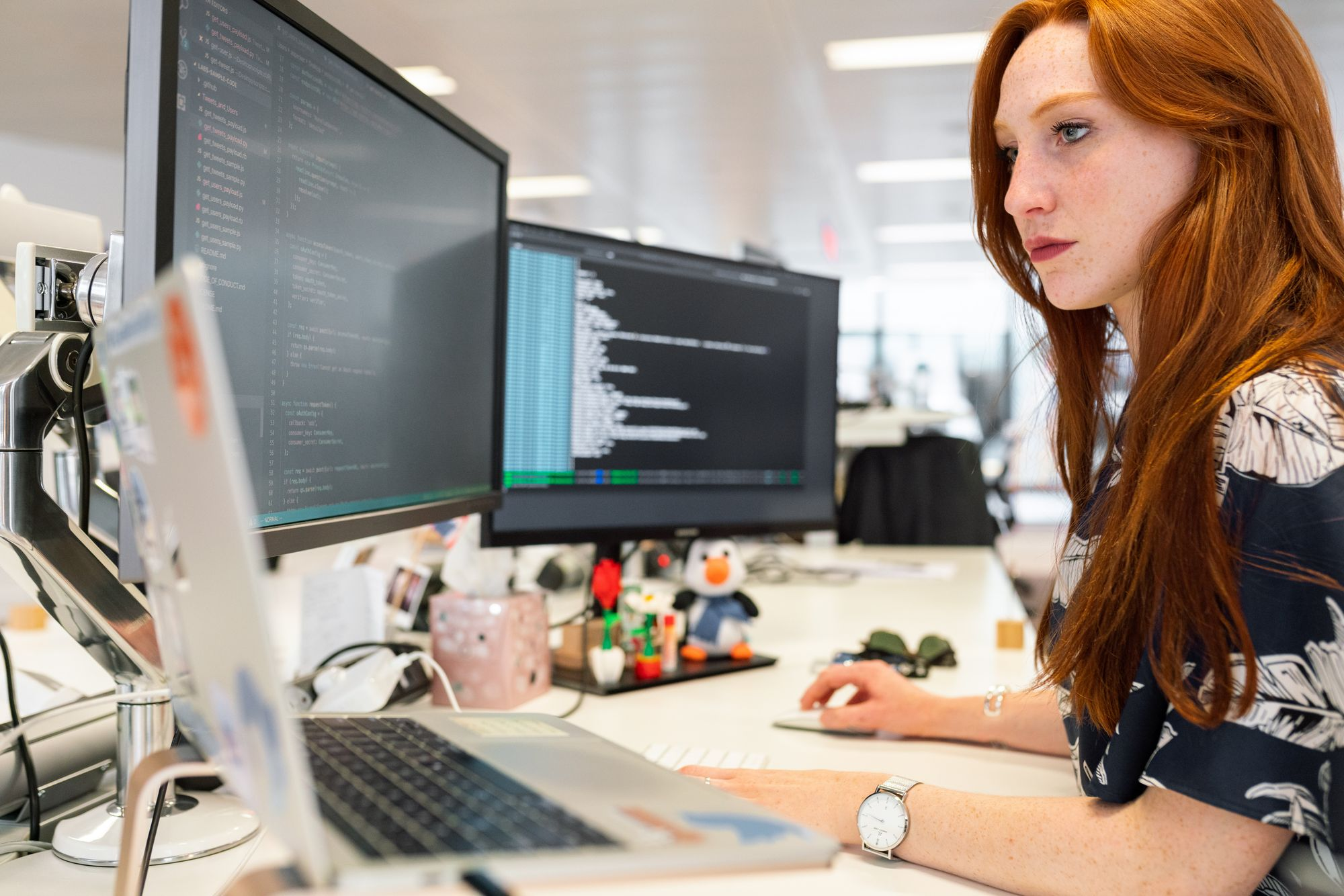woman coding and doing software maintenance