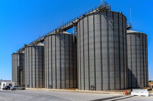 DevOps Silos_Four big manufacturing tanks